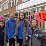 Children stand outside Saint Christina's on first day back at school